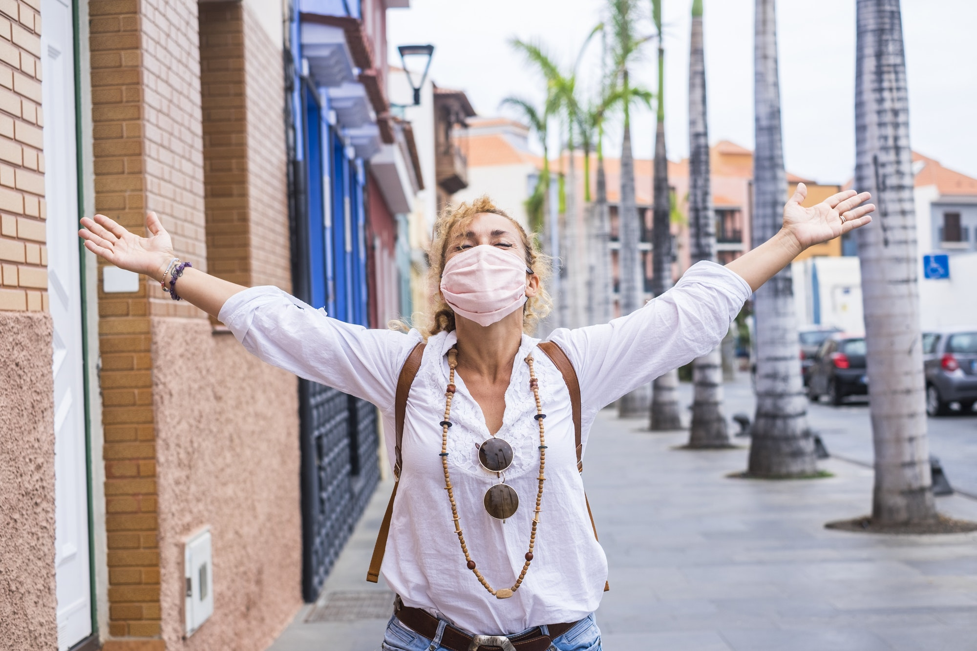 Happy woman celebrate the end of the pandemic emergency