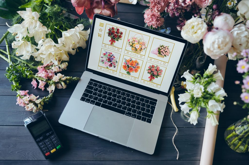 Above view of open laptop with flower shop website